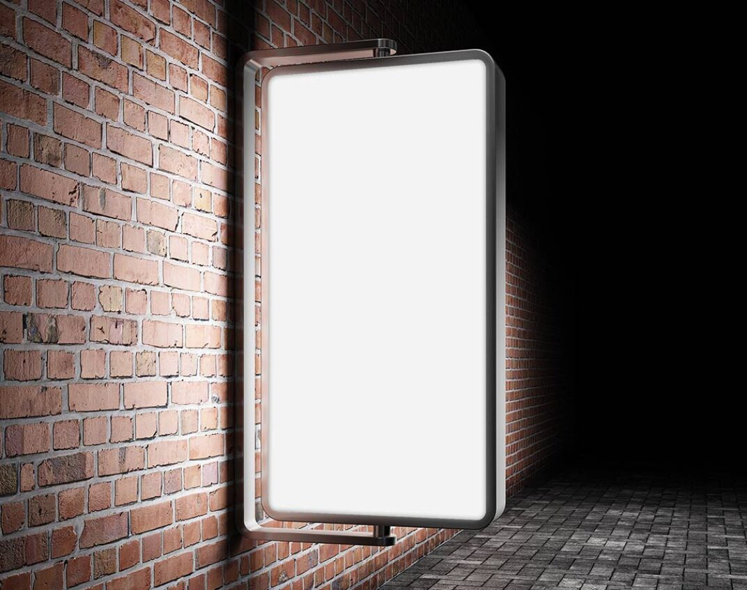 Illuminated and wall-mounted outdoor Billboard Mockup FREE download