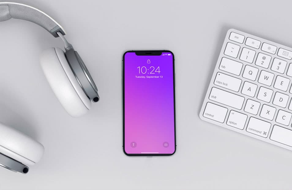 Modern iPhone X Mockup on a Workspace FREE download